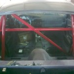 83. Roll cage being fitted, not the absence of rear screen