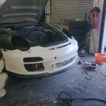 21. Front bumper being lined up to wing